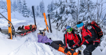 25109382 - ski patrol team rescue woman skier with broken leg