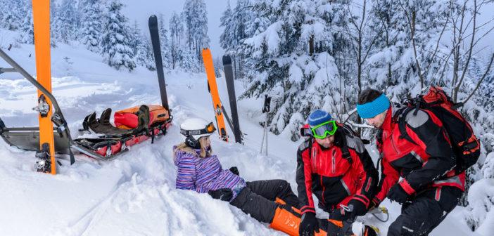 25109382 - ski patrol team rescue woman skier with broken leg