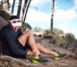 28176314 - running injury for trail runner on mountain twisted ankle