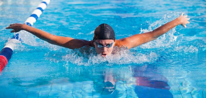 40854880 - butterfly swimmer in cap and glasses in the pool