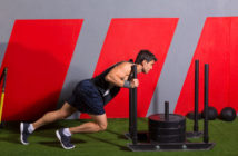 27491439 - sled push man pushing weights workout exercise at gym