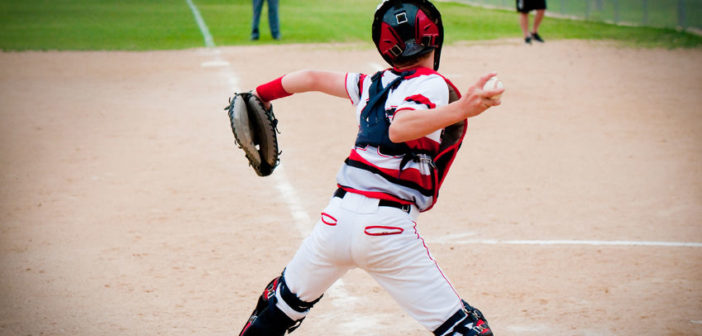 56747592 - american baseball catcher throwing ball.